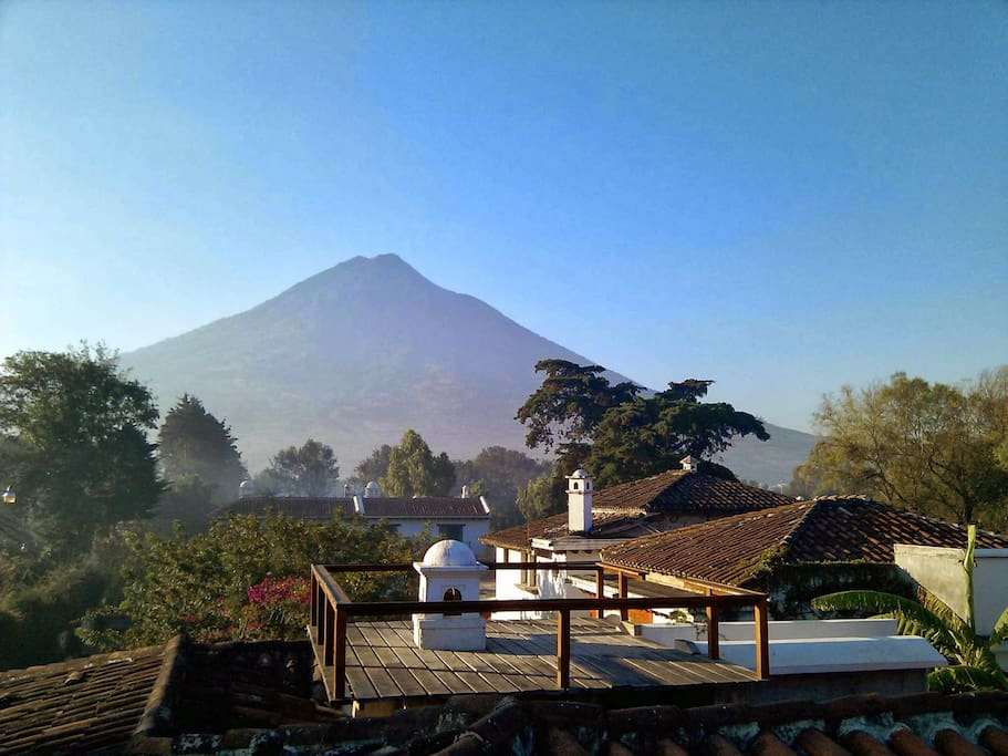 Rooftop view of Agua Volcano and surrounding gardens.