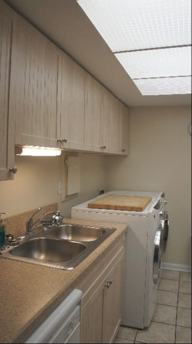 Well equiped galley kitchen with full size washer and dryer.