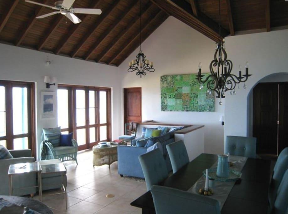 Great room - mahogany doors and windows open to ocean balconies