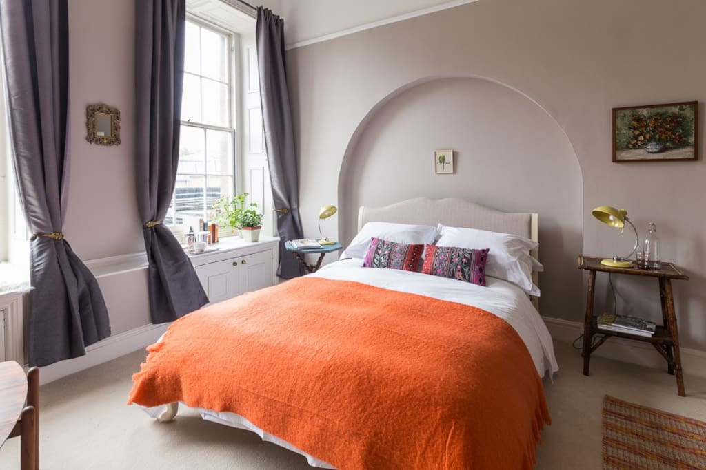 Two large windows overlook the gardens in our newly decorated, luxurious room