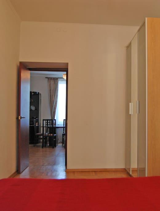 1st bed room with wardrobe. You can see also the part of living room. 1-я спальня, на фотографии видна также часть жилой комнаты.