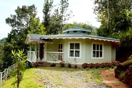 Natureroots Villa is located near Munnar in a farm land, well furnished villa with basic kitchen facilities and small balconies. we do offer breakfast on request, off road drive to visit farm, hiking etc. Seasonal rates: $79/day (Dec1st to Jan 31st)