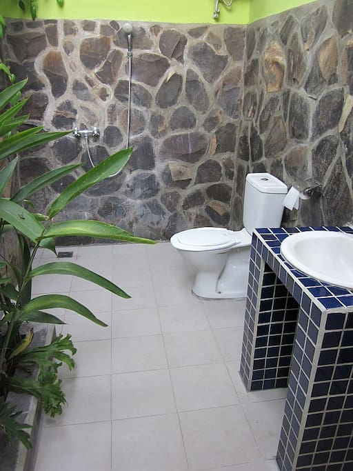 Enjoy our Balinese style open air bathroom with garden and hot shower