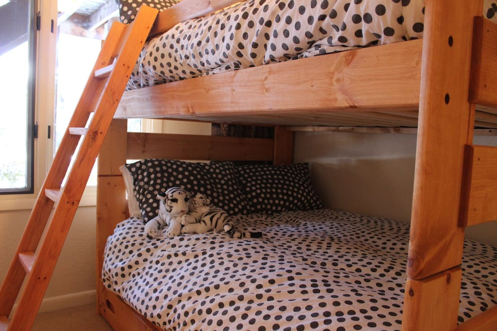 Bunk room wiht two full size beds and trundle bed