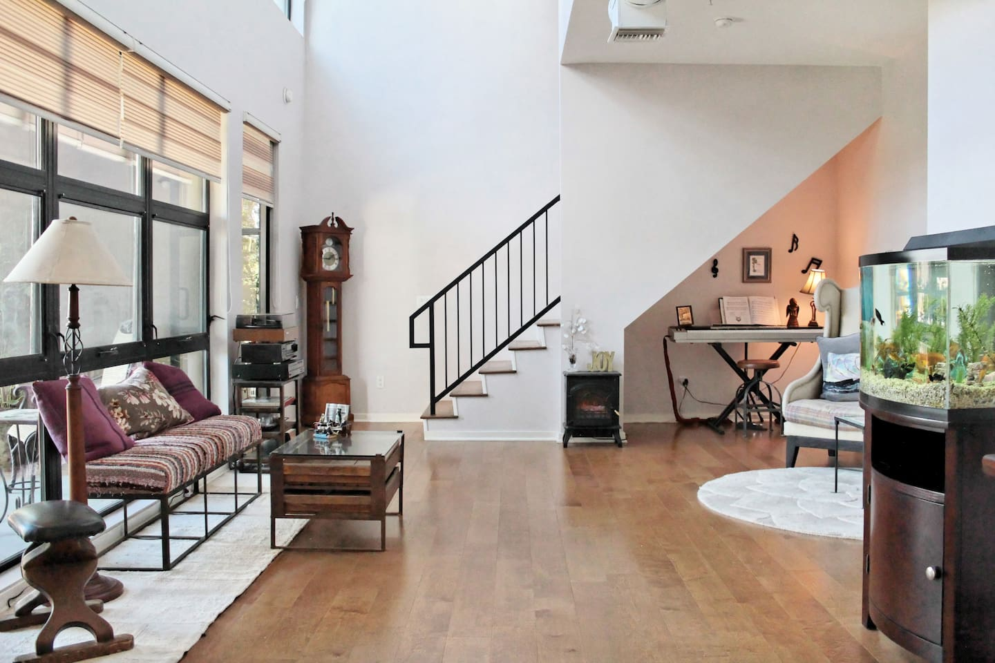 Open and spacious living room--two doors leading to lower balcony.
