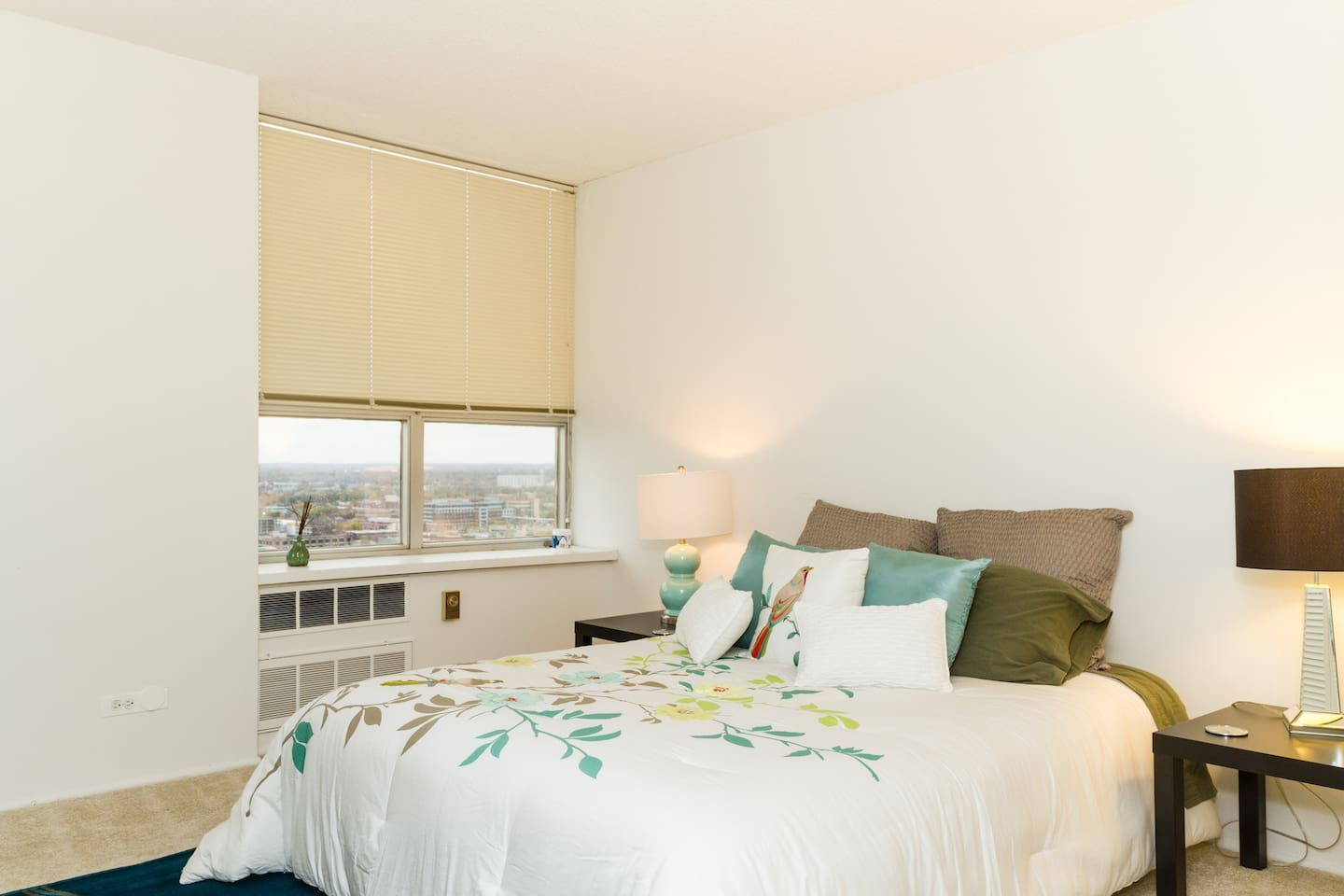 The bedroom offers wonderful views of Indy and is independent from the other bedroom offering privacy and comfort.
