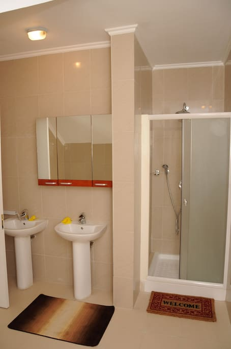 bathroom with rain shower heads and 24 hours hot water
