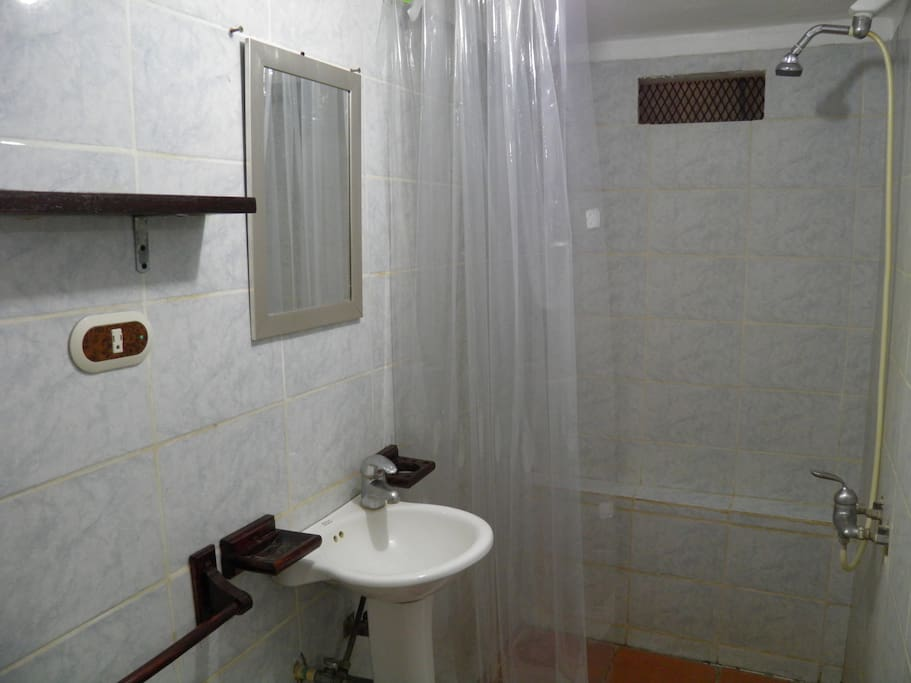A clean bathroom with all the amenities, like hot water