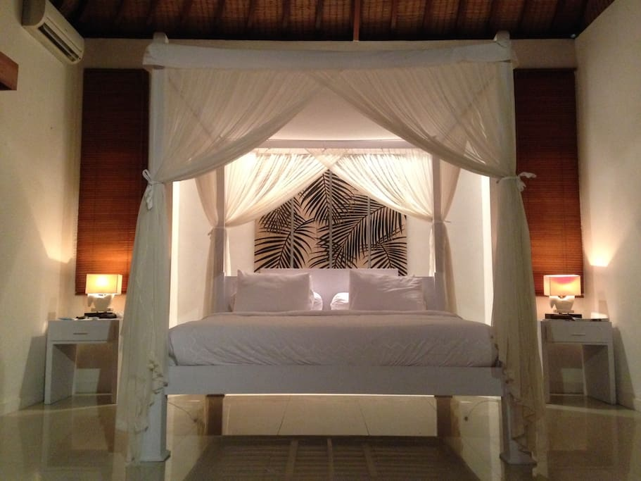 Bedroom features a king-sized canopy bed