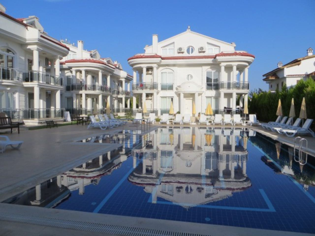 Our Apartments' pristine grounds with  generous pool &  terraces.