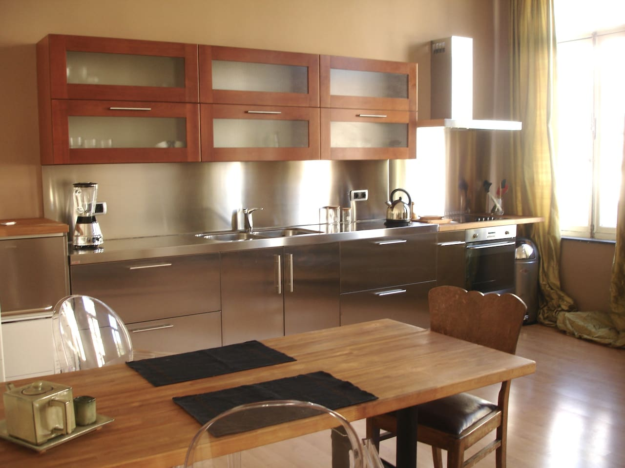 Kitchen and dining area. Top quality kitchen furniture and appliances. LOTS of light.