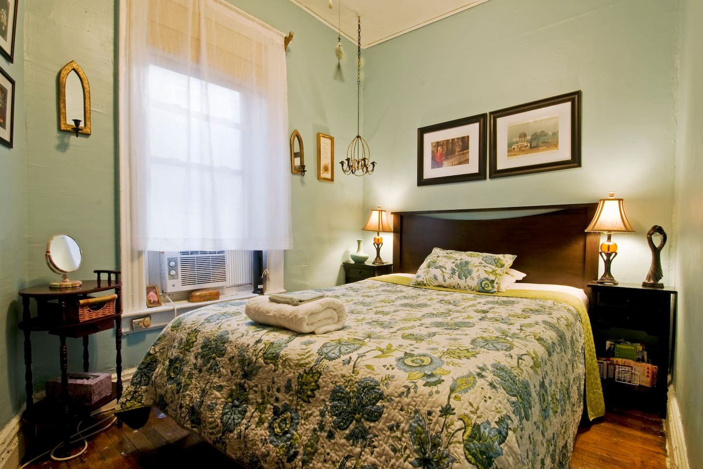 the guest bedroom with a queen size bed