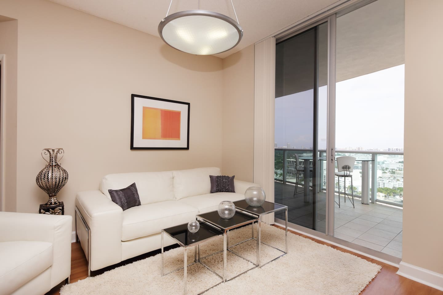 Luxury Living Room With Cable HDTV and Wi-Fi that Opens Up to the Balcony Over Looking The City and Ocean