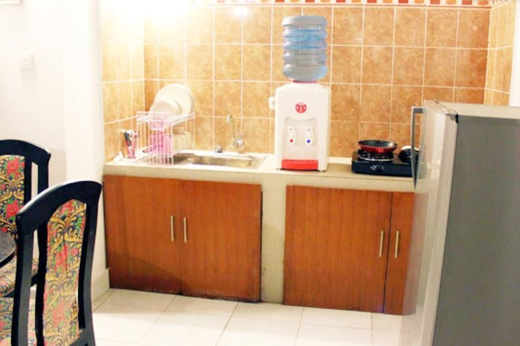 Full Kitchen with complete dish set, sink, FREE clean drinking water, modern new stove and refrigerator