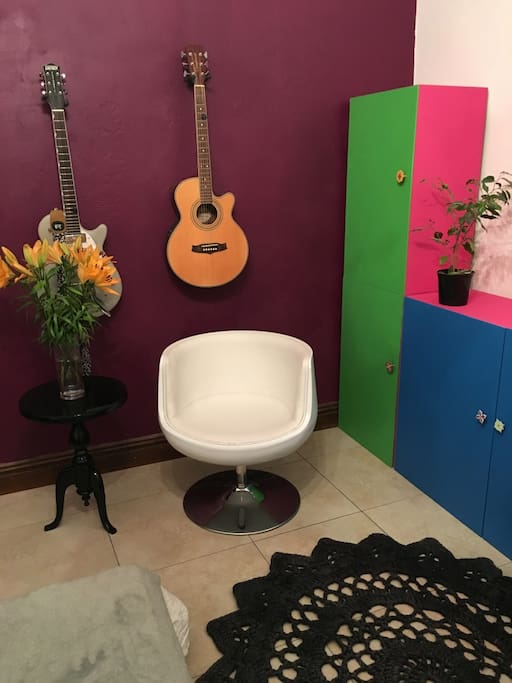 Colourful, Mexican inspired guest room! Sleeper couch & custom made divider with little door & made to allow plenty of light in!