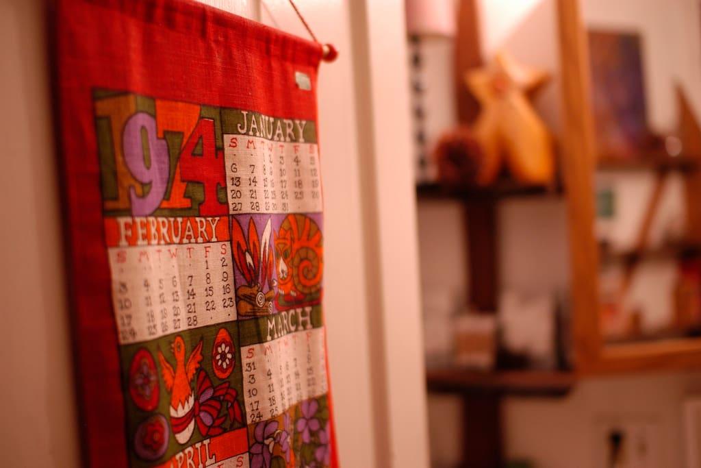 Linen calendar from 1974 hangs on our bathroom door.