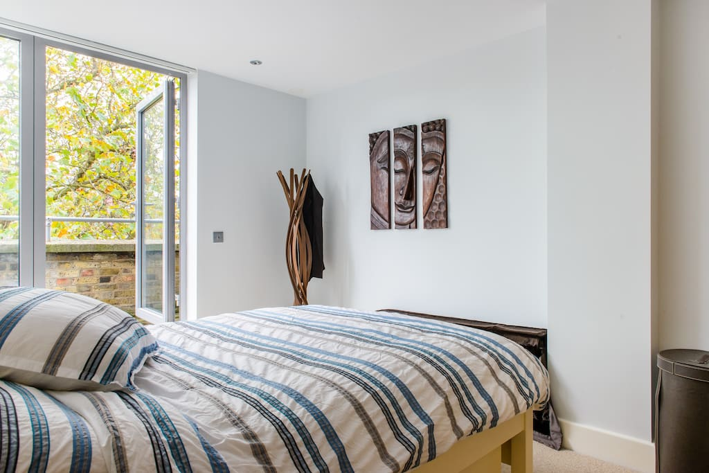 Spacious, light-filled en suite bedroom with excellent double bed.