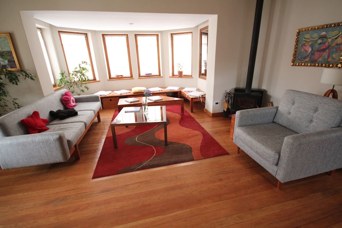 Our house is recently renovated features a large lounge with wood fire.