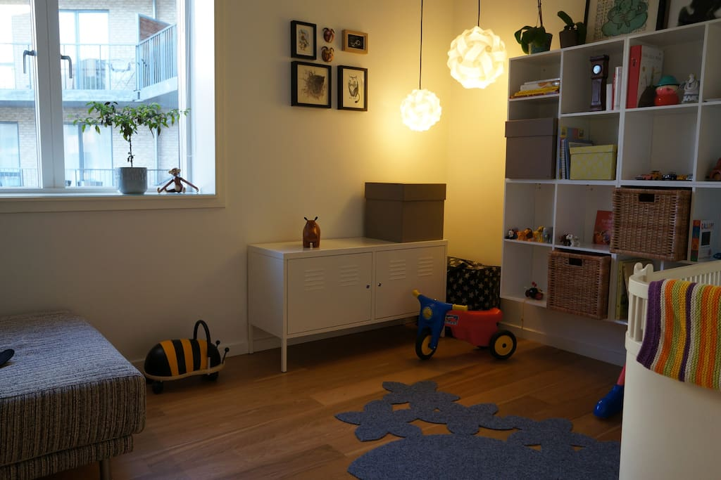 Childrens room with baby bed