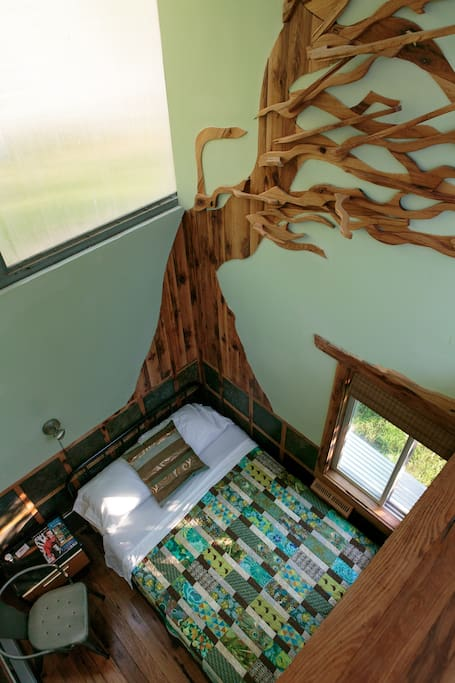 The interior of the room with towering ceiling and beautiful  a wood design.
