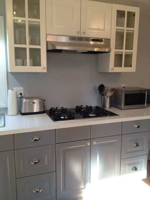 Full 4 burner gas range, toaster and microwave for your culinary needs