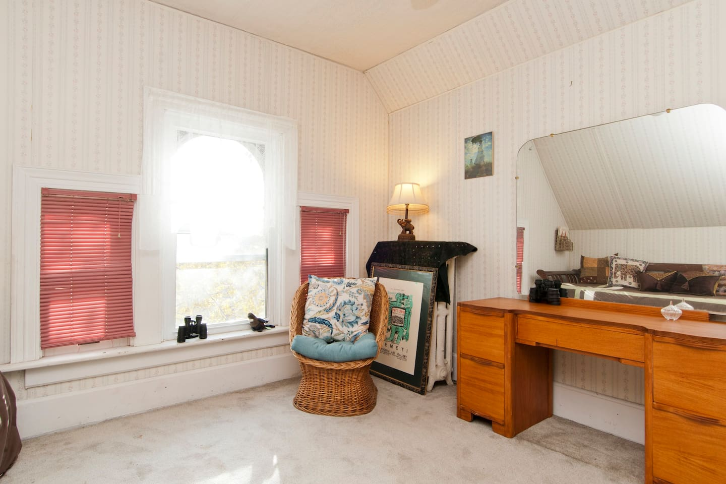 This is a single room with vintage waterfall vanity/dresser, single sleigh daybed, cute and  (trundle) sunny with a view of the street.  We also have a large double room in a separate airbnb listing (Close to Everything).