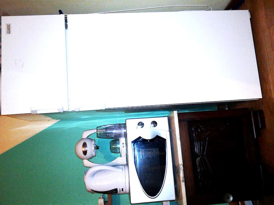 refrigerator, microwave, kettle and smoothie maker.