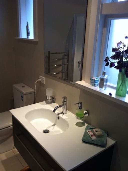 bathroom with bath, separate shower and toilet. 2nd toilet off laundry