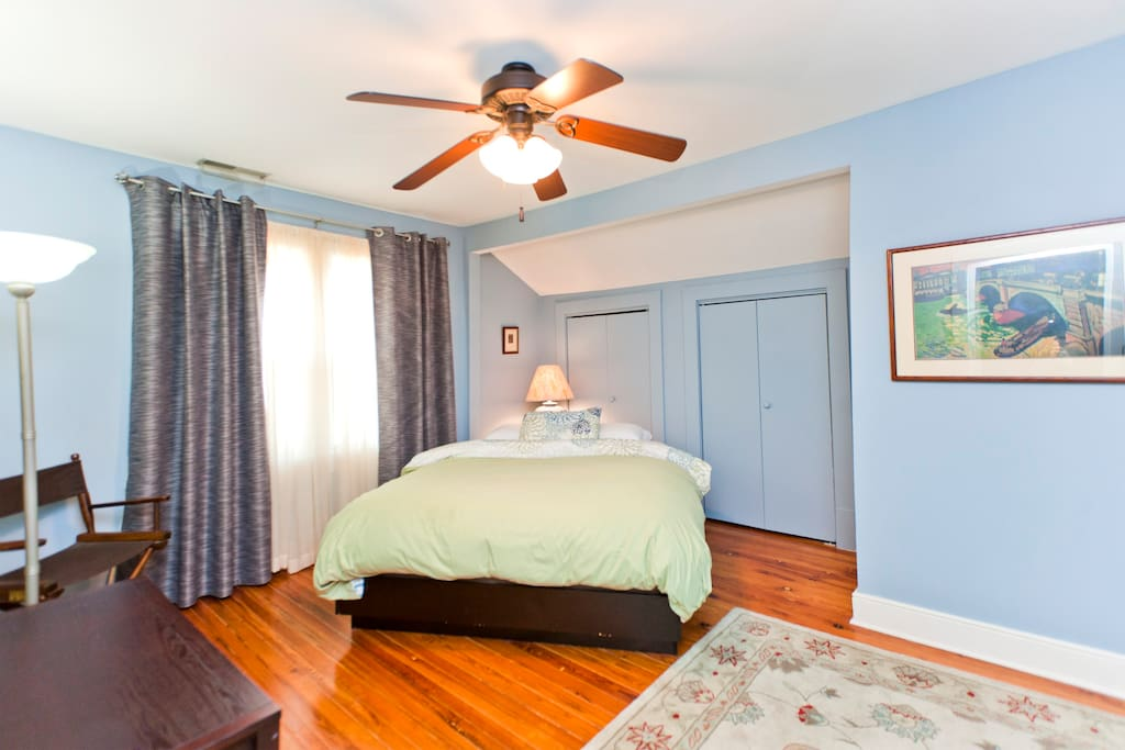 The additional  bedroom - also on the second floor with a bathroom right outside the bedroom.  Queen bed, overhead fan and blackout drapes.