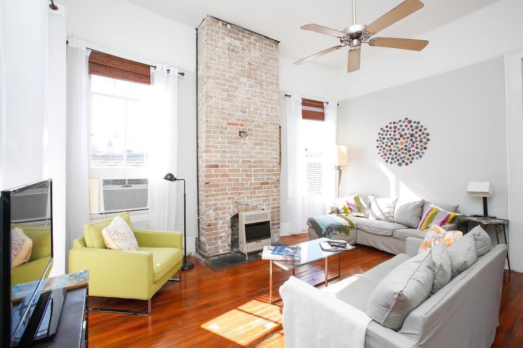Ultra-comfy living room for tv-watching, good conversations, or just hanging out. Ignore the window unit & heater; they're GONE!