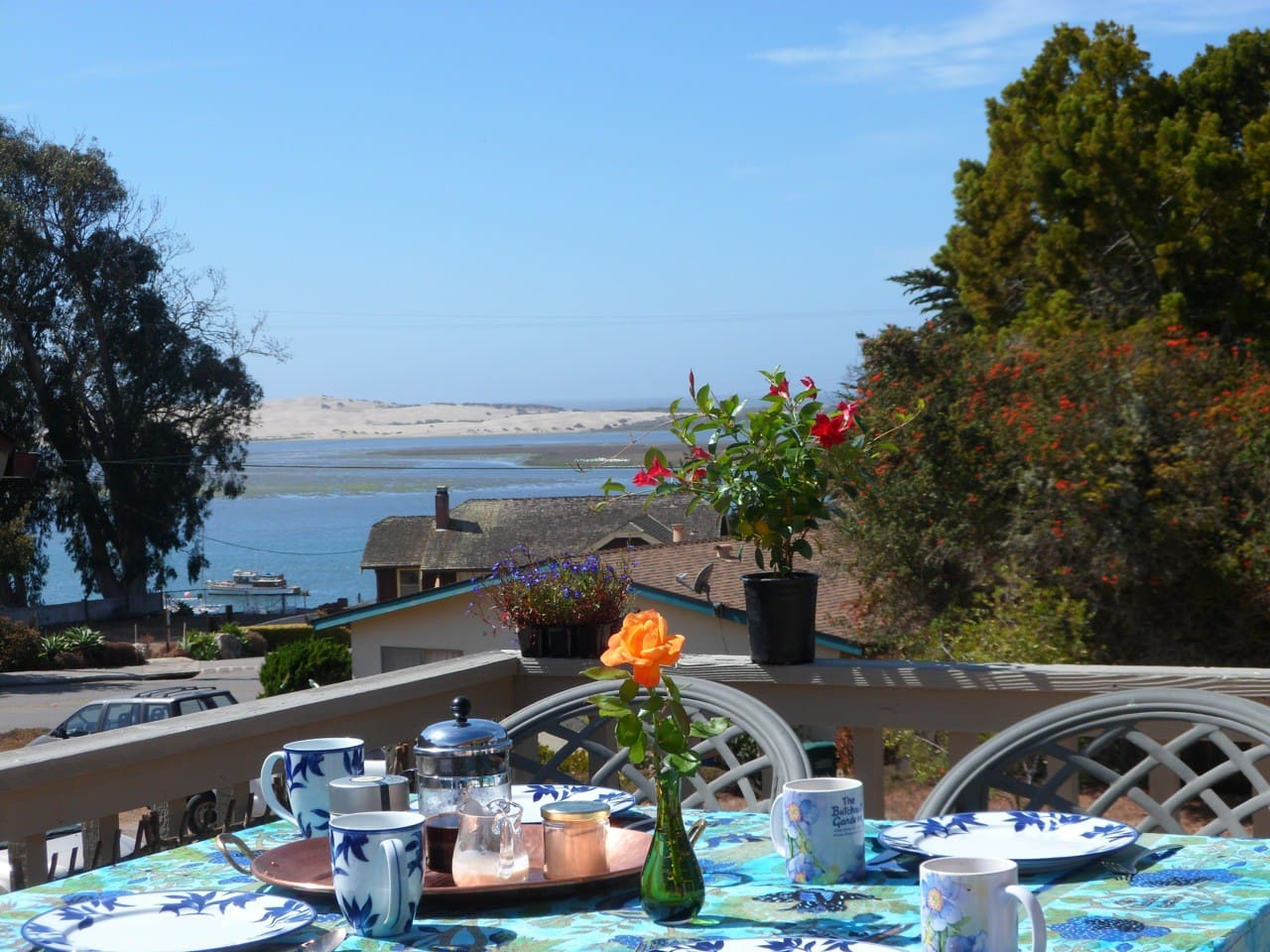 Enjoy breakfast on the deck with sweeping views of the bay, dunes, and ocean.