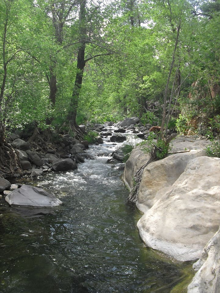 This is the creek, below the house that you can walk to. There is a big flat rock that you can sit, fish, or just enjoy the beauty.
