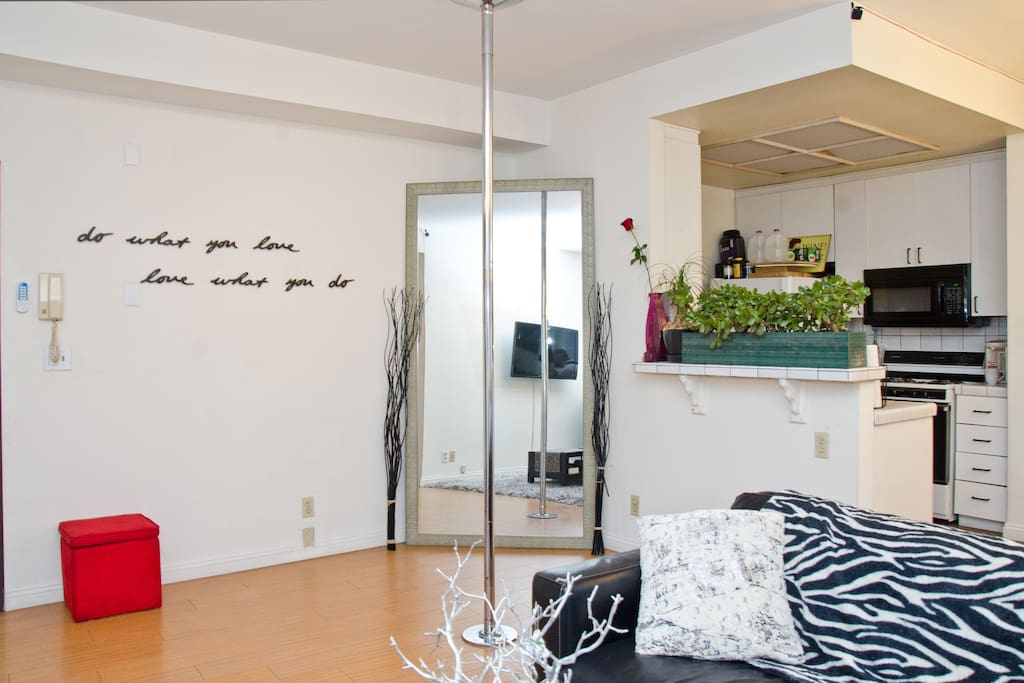 Sit back, relax, and enjoy a modern living and dining area with hardwood floors throughout.