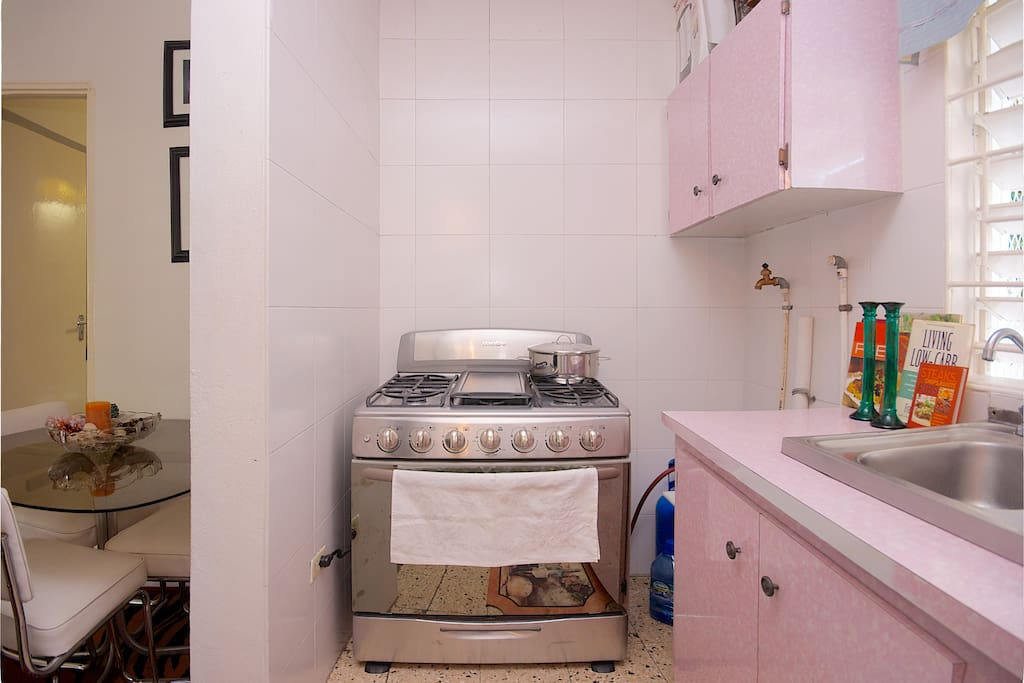 Huge,six burner,  stainless steel stove with oven.