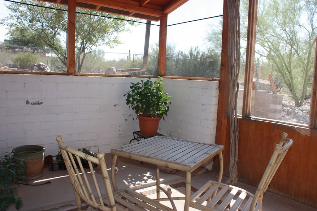 a large, enclosed porch offers a quiet place for reading, sipping  tea or yoga practice