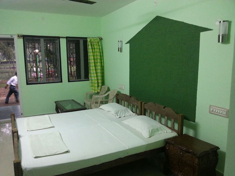 Beds in standard room with lake view at majaliresort karwar India( near Goa )