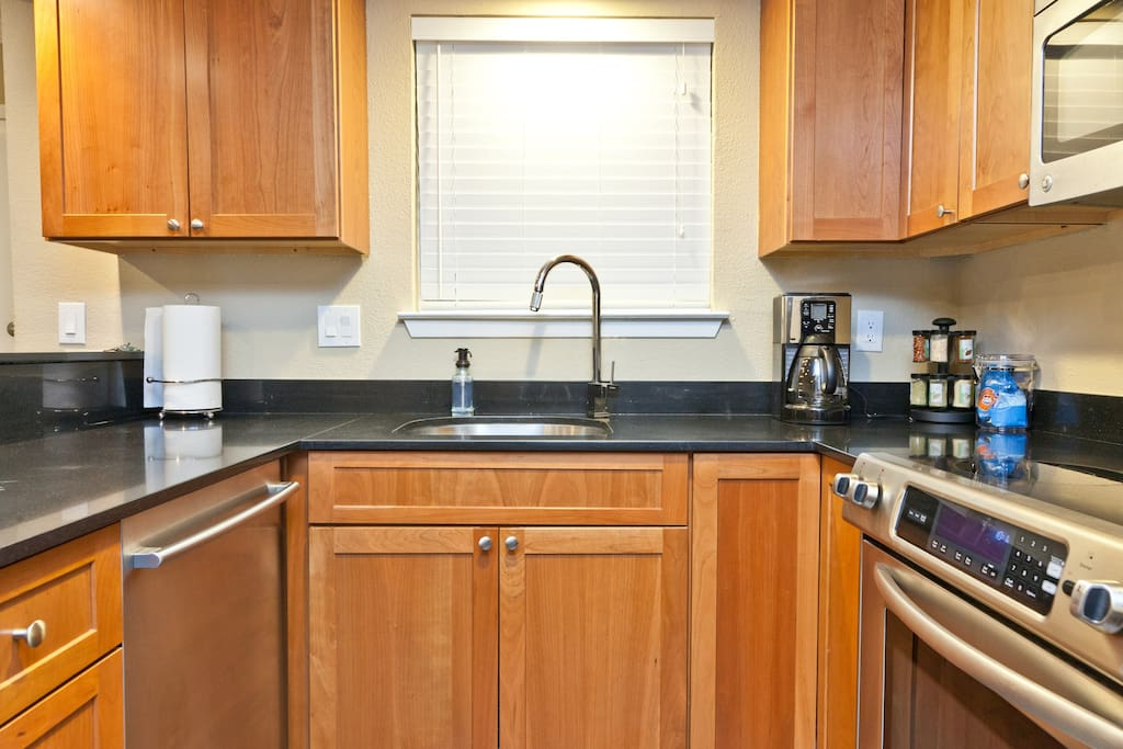 Coffee maker, toaster, cooking pots/pans, dinner ware, utensils, and spices.