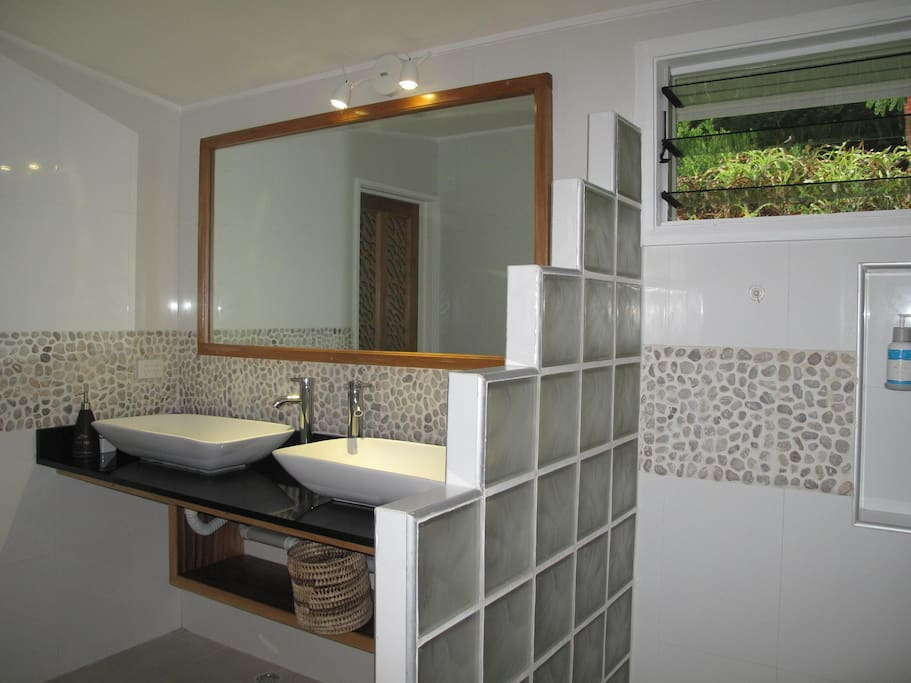 His and Her handbasin, large rainhead shower leading to private outdoor shower