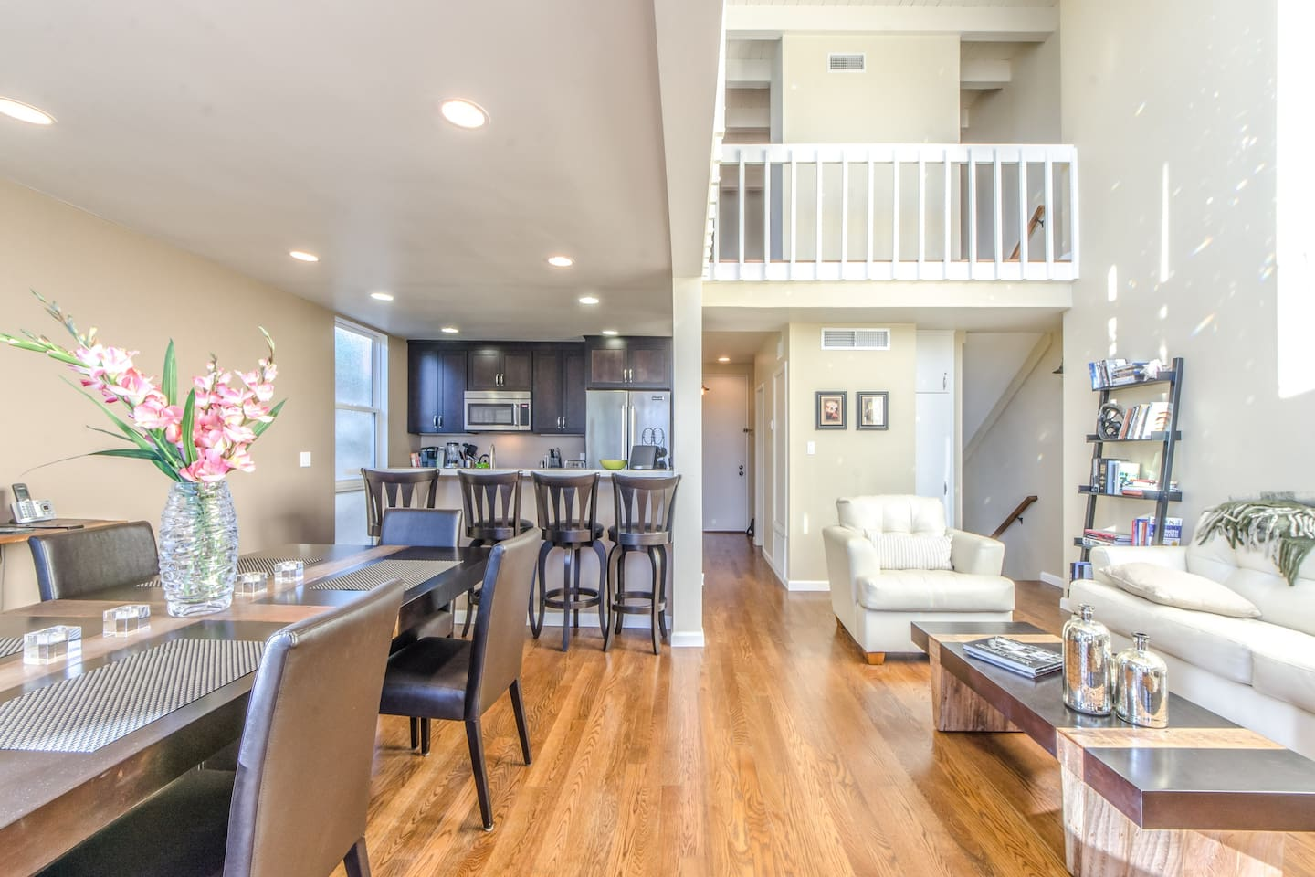Wide angle view of living room, dining room, and upstairs