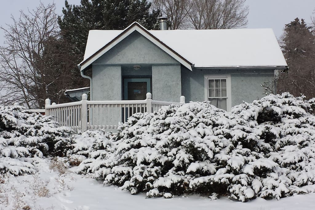 Charming house covered in snow. We don't get this much snow on a regular basis, but when we do, we enjoy it!