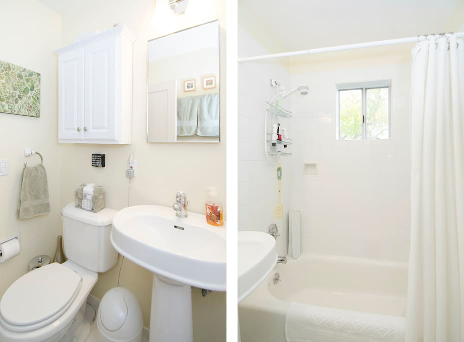 Bright bathroom with bath and shower combo.