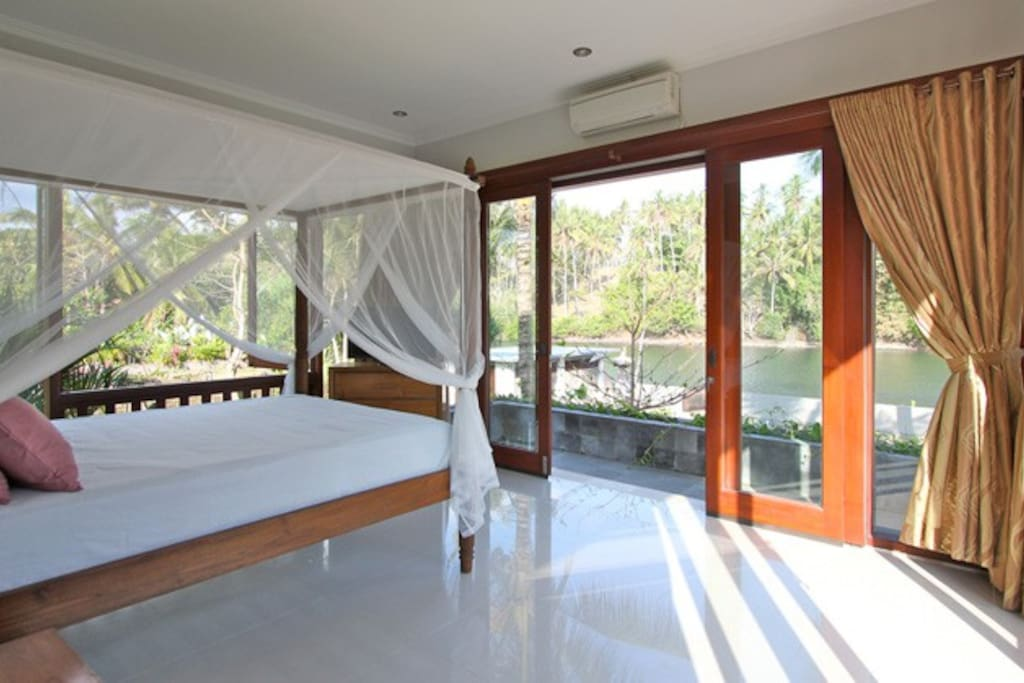 Interior photo of guest house which overlooks river.