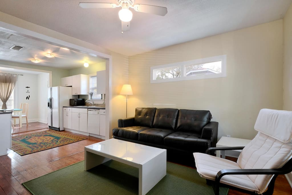 The open floor plan flows from the living room to the kitchen and dining