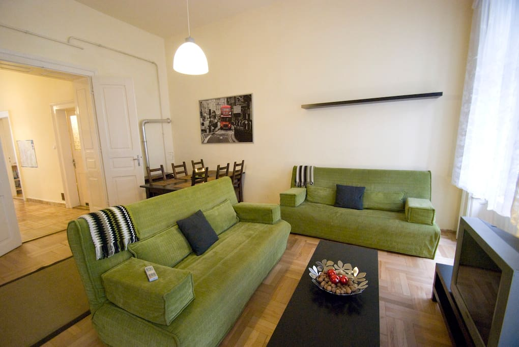 living room with two roll-away sofas and flat screen cable TV with world channels and fast & secured WiFi internet access