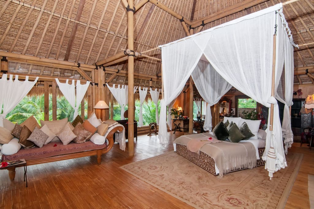 Top Bedroom suit of Lila bamboo villa. surrounded by silks and velvets Balines antik Batiks and a beautiful hand woven Elang Elang roof created by Bali's master Bamboo builder Pak Kantor. Views over look rice fields, embraced by nature.