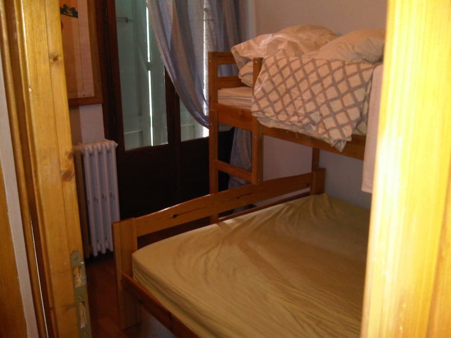 Bedroom 3: Third bedroom has double bed with single bunk above, plus closet