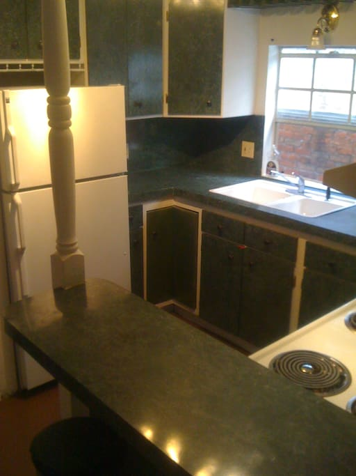 Full Kitchen with full sized refrigerator, stove, coffee maker, plates, pots, etc.