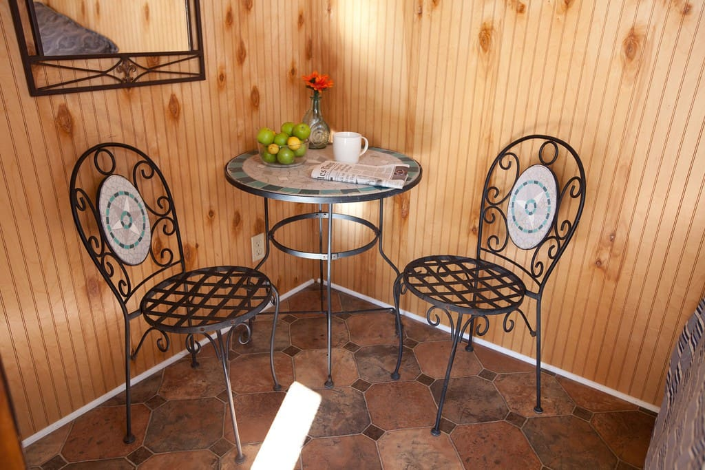 with a little bistro table and chairs plus a full-length clothes rod/closet in the bedroom.