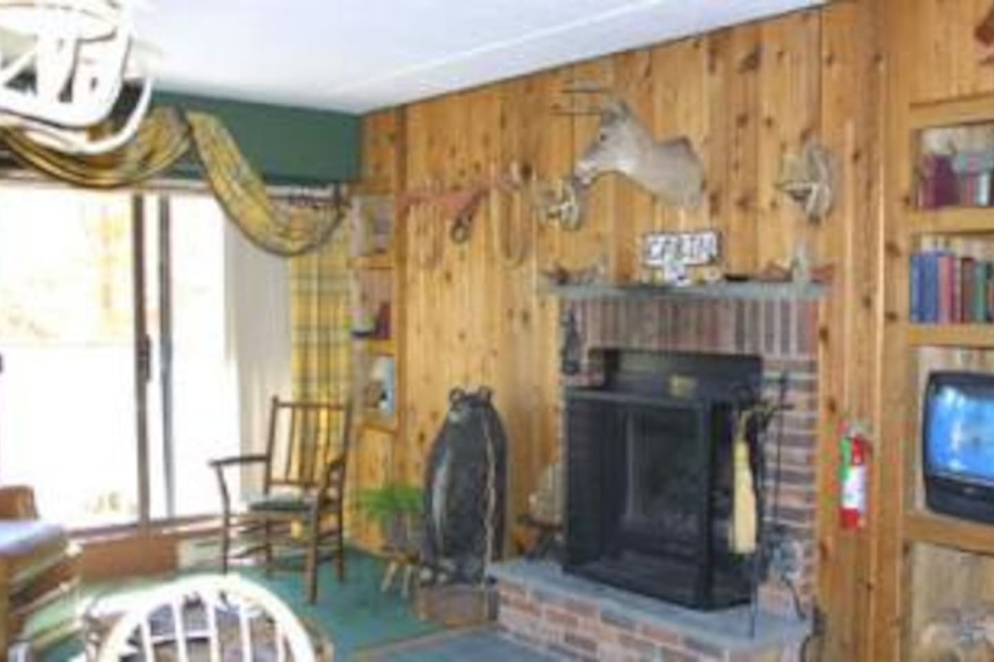 Living room with wood burning fireplace, balcony with views of golf course and Killington Mountain  and free firewood!