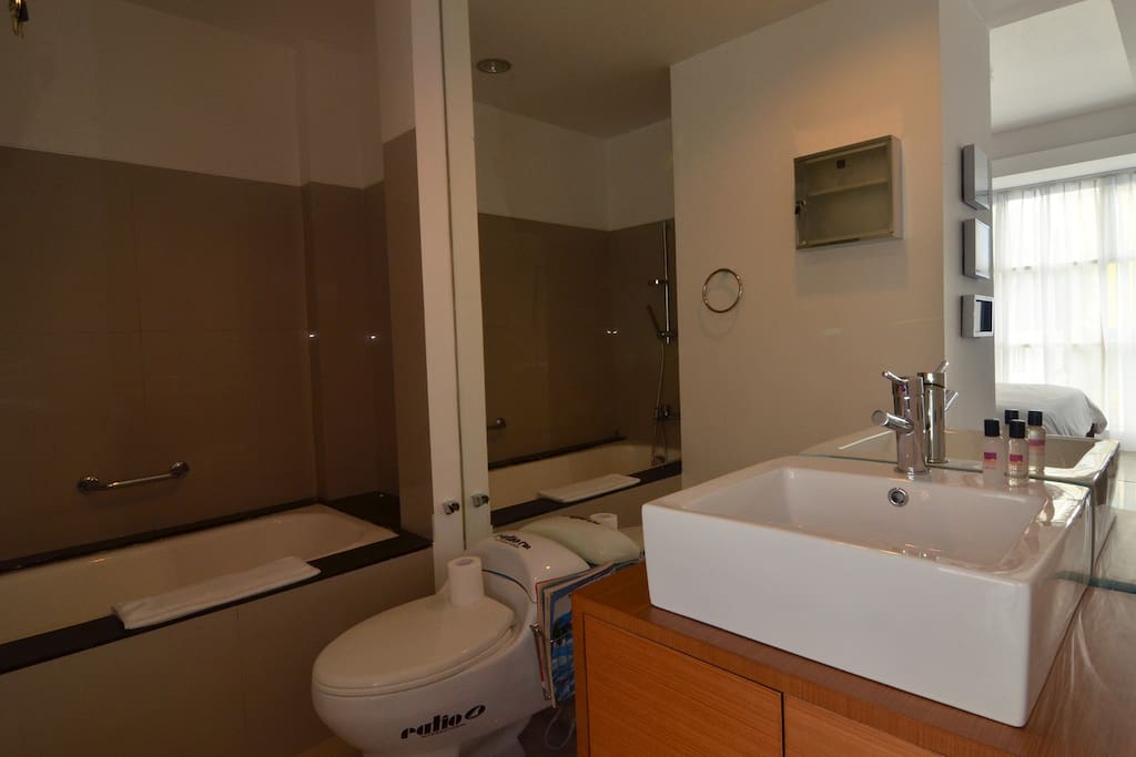 This is the first bathroom, a doorless one with bathtub. Use it if you have privacy.